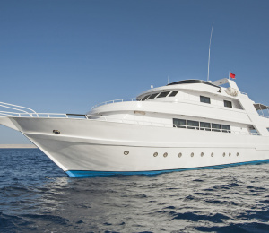 Large luxury private motor yacht out on a tropical sea